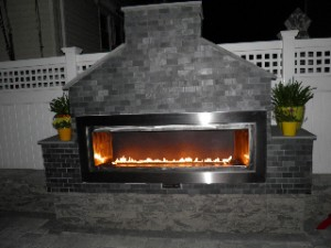 Fiamma Linea Outdoor Ribbon burner fireplace. Made out of Stainless Steel.